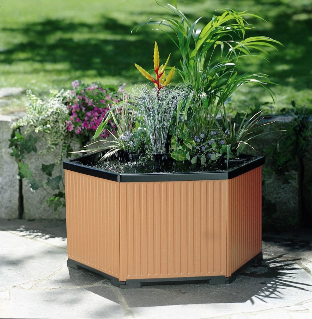 Petits bassins de jardin comment les installer for Kit bassin jardin