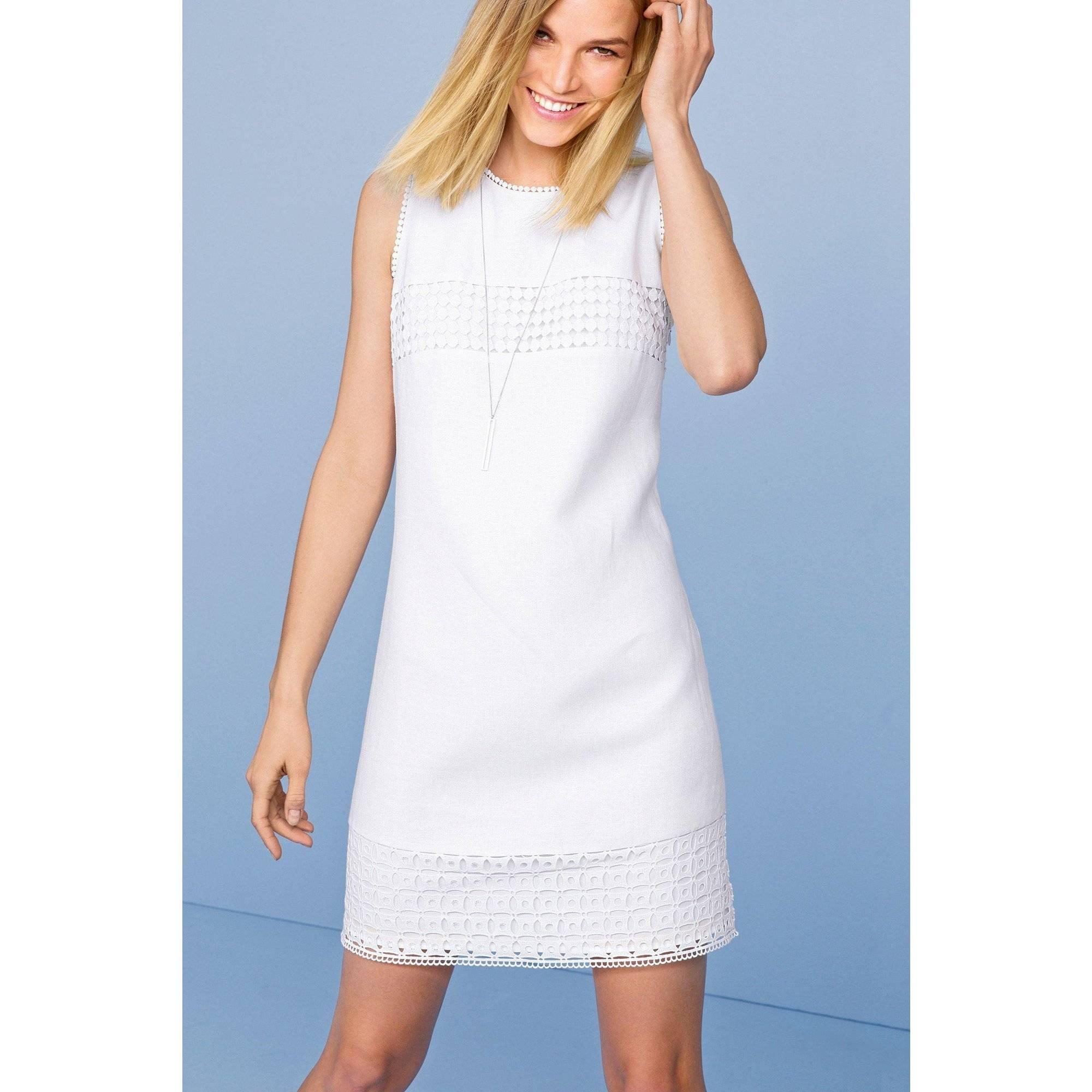 Quelle veste porter avec une robe blanche